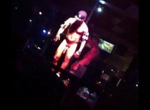 Dark-hued fellow stripper dancing at..