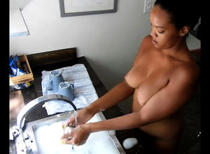 Nude and washing dishes with black..