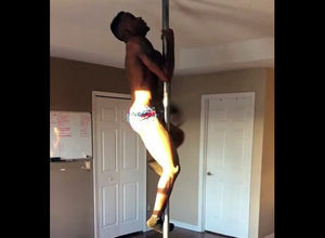 Dark-hued male stripper rolling on a..